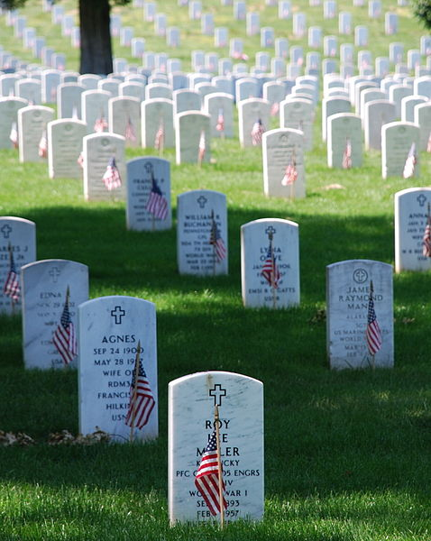 Gravestones at Arlington National Cemetery decorated by U.S. flags on Memorial Day weekend. Photo:Public domain