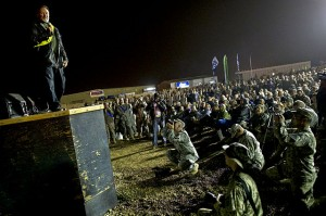 Comedian Robin Williams performs at the USO holiday tour show at Camp Victory, Iraq, Dec 13, 2010.  Photo:United States Army(public domain)