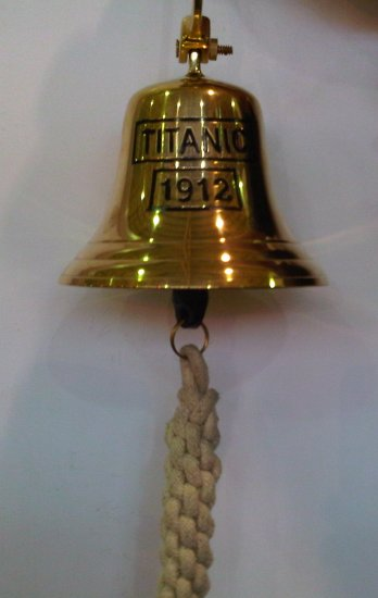 A commonly found reproduction of Titanic crows nest bell sold to museum and exhibition visitors.