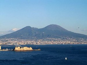 Bay of Naples today with Mt. Vesuvius in the background. The densely populated city of Naples lies nearby. Public Domain