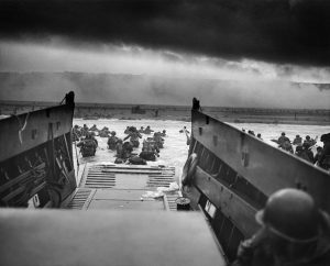"""Into The Jaws of Death"" U.S. troops from Company E, 16th Infantry, 1st Infantry Division disembarking landing craft on 6 June 1944. Photo:Chief Photographer's Mate Robert F. Sargent Public Domain (National Archives and Records Administration)"
