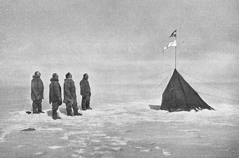 Roald Amundsen and his crew looking at the Norwegian flag at the South Pole, 1911 Public Domain(Project Gutenberg Literary Archive Foundation)